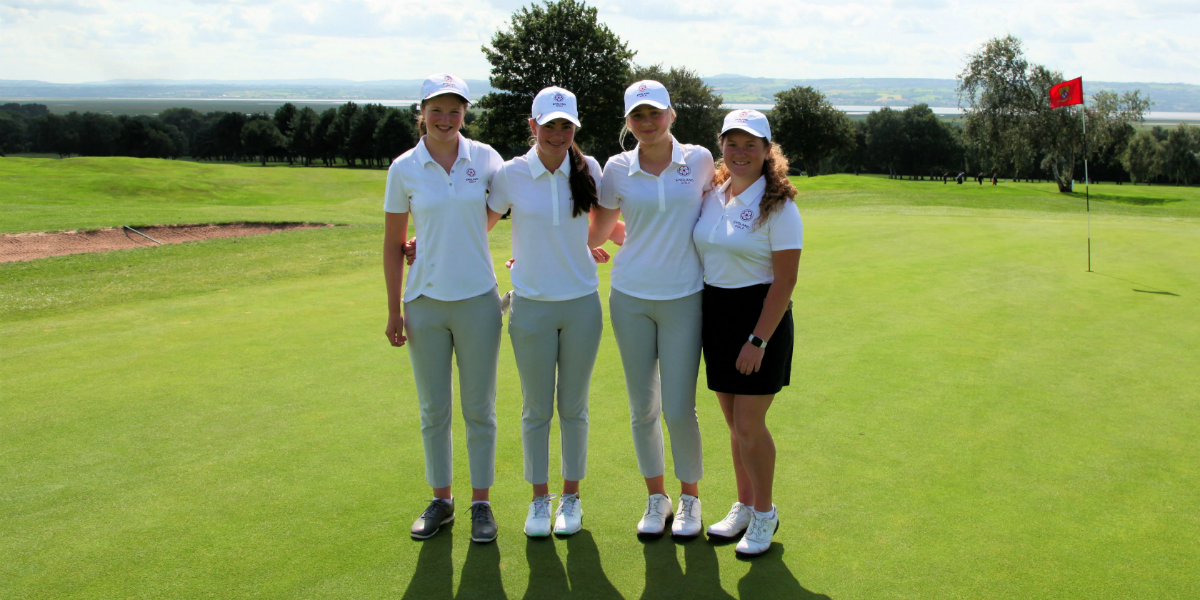 England Under-16 girls team stand on the green
